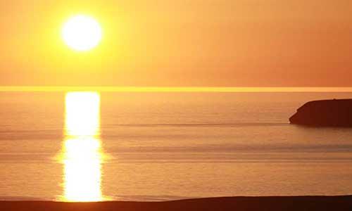Solnedgång på Island med Riding Iceland